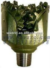 Green tricone steel tooth bit