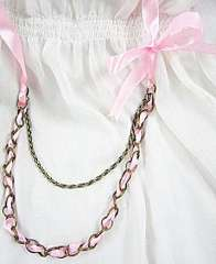 Edgy pink ribbon metal necklace