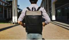 Use House Korean men's fashion leisure travel backpack embossed PU Leather