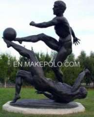 Playing football sculpture