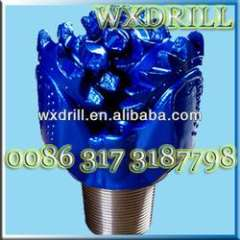 Steel tooth tricone bit for well drilling